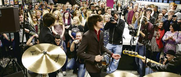 The Strypes celebrating the return of HMVat the store's reopening on Dublin's Henry Street.