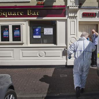 Garda forensic officers search the Square Bar in Market Street, Bailieborough in County Cavan where a man barricaded himself in the pub armed with a shotgun.