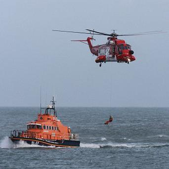 The man, who was in his 40s, is suspected of falling in to the water at Howth, north Dublin, while rock fishing