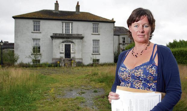 REPOSSESSED: Jillian Godsil, pictured outside Raheengraney House near Shillelagh, Co Wicklow, has €1m in mortgage debt which she has no hope of paying back along with smaller debts to two creditors. Photo: Frank McGrath