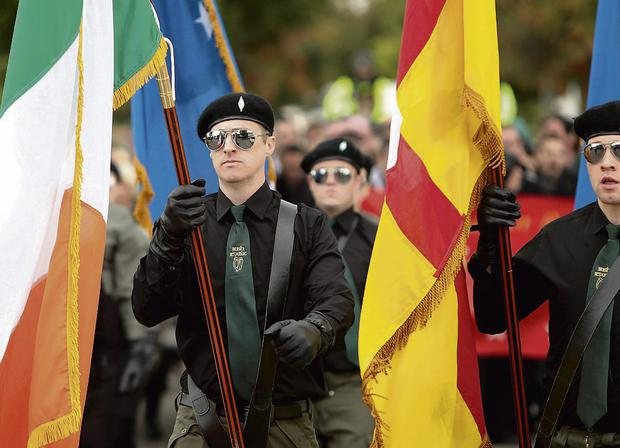 Men and women in paramilitary uniforms, top, make their way to Balgriffin cemetery for the memorial ceremony.