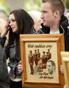 Friends and supporters, left, at the memorial for murdered 'republican' figure Alan Ryan.