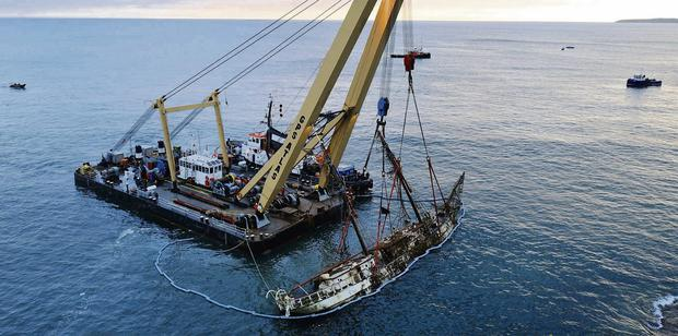 A floating crane raises the wreck of the Astrid off Co Cork