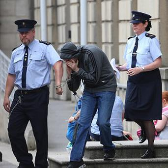 Eric Eoin Marques is led away from the High Court in Dublin