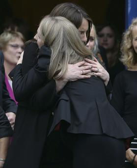 Susan FitzGerald's daughters Sarah and Sophie at her funeral at the Church of the Three Patrons in Rathgar, Dublin