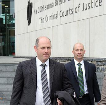 FBI special agent Brooke Donahue (right) with Detective Inspector Declan Daly leaves the High Court in Dublin following the extradition hearing of Eric Eoin Marques who is wanted in America where he is accused of being the largest facilitator of child porn in the world