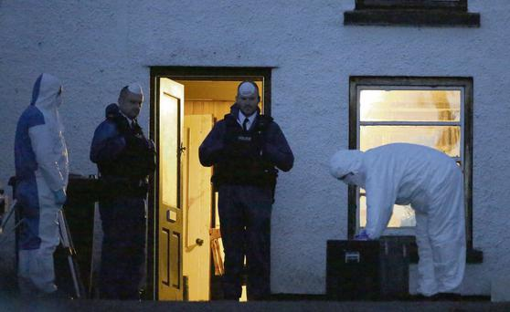 Forensic officers at the scene on the farm outside Glenarm, Co Antrim.