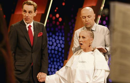 Majella O'Donnell holds Ryan Tubridy's hand as she gets her head shaved on live TV