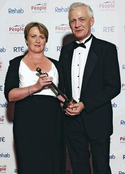 Fionnbarr and Elma Walsh with Donal's award