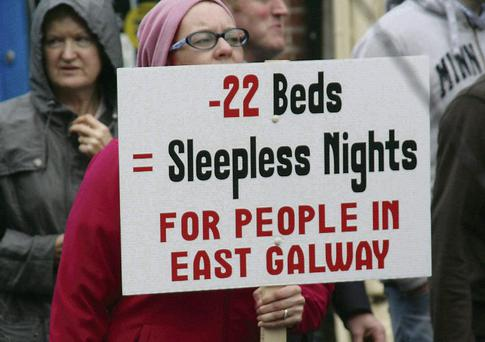 A protester holds a sign at the rally in Ballinasloe, Co Galway