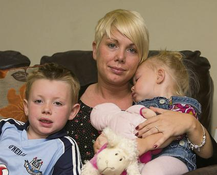 Stephanie Meehan with her children Oisin and Cerys at their home in Belmayne, Dublin