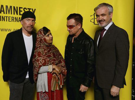 The Edge with Malala, Bono and Amnesty's Colm O'Gorman at the ceremony at the Mansion House last night