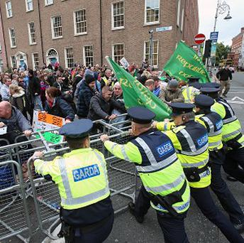 Gardai push against barriers as protesters gather outside Leinster House, Dublin, as politicians return after the summer recess