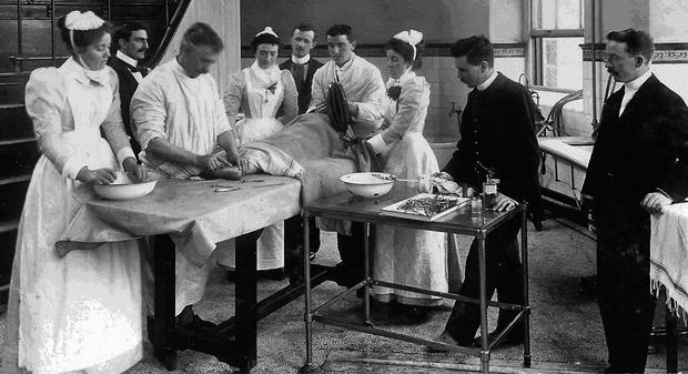 Surgery under way in the main operating theatre in the Mater in 1892