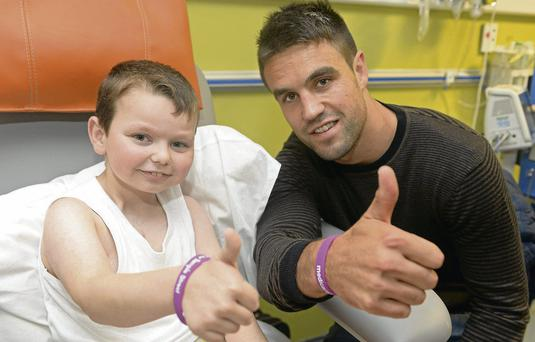 Conor Murray with Luke Concannon, (8) from Lucan