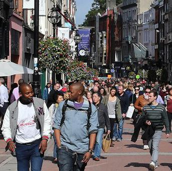 Shoppers on Dublin's Grafton Street, on the day Ireland officially exited its recession