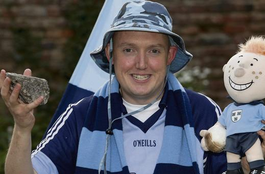 Dublin superfan Cian Burgess with his piece of the Hill