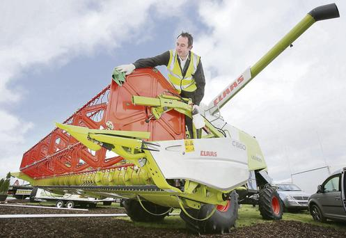 JP Betts from Cahir polishes up a Claas Combine Harvester - if you have an old machine its best to get is serviced.