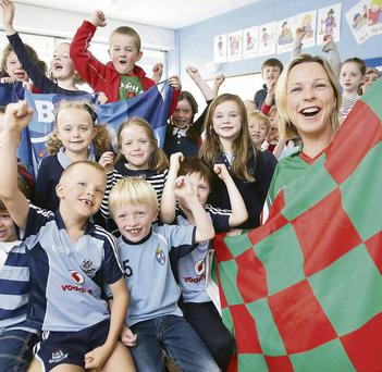 Teacher Bernie Gearoid, from Mayo, with first class pupils at Scoil Bhride in Ranelagh, Dublin yesterday
