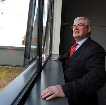 Tanaiste Eamon Gilmore has claimed the Government should do 'no more than is necessary' on October 15