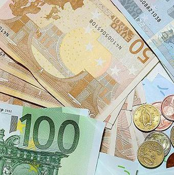 A six-figure cash haul was found by a plumber working in a property which was repossessed last year from bankrupt-billionaire Tom McFeely