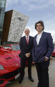 'Sunday Independent' Business Editor Nick Webb, right, and Charles Hurst franchise director Richard Stinson with the Ferrari 458