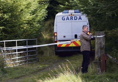 Garda at the scene of the discovery last weekend of the remains of Elaine O'Hara at Kilakee in the Dublin mountains