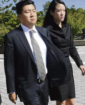 Goldman Sachs managing director Jason Lee, above, with his wife Alicia
