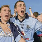Dublin supporters Keith McCarthy and Jason Weldy celebrate Dublin's win at Croke Park