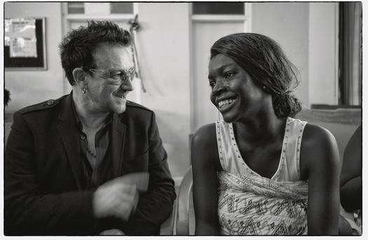 Bono meets a mother at an antenatal clinic in Accra on a recent visit to Ghana