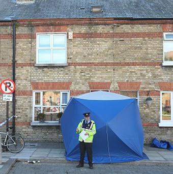 Garda outside a house on Ormond Square in Dublin, where a man was found stabbed to death