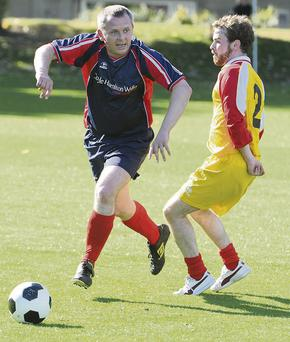 Independent TD Richard Boyd Barrett takes part in a charity football match against the Dail Ushers in aid of homeless people