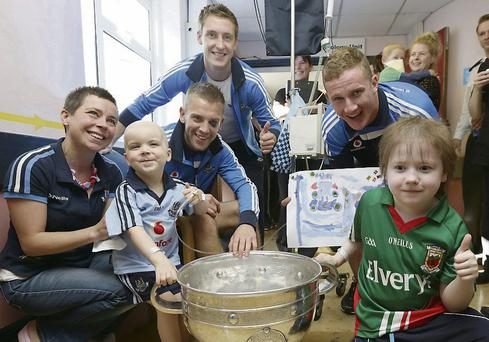 Dublin stars Johnny Cooper, Kevin Nolan and Ciaran Kilkenny with Elaine Mullarkey, her daughter Brea (3) and Mayo supporter Rory Carroll