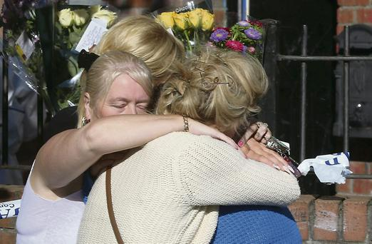 Relatives lay flowers at the scene in Tallaght, Dublin