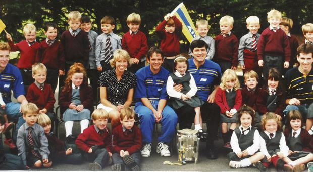 Davy Fitzgerald brings the Liam MacCarthy Cup to St John's NS in Cratloe back in 1995 with future Clare stars Conor McGrath (1), Liam Markham (2) and Conor Ryan (3) on hand to see it
