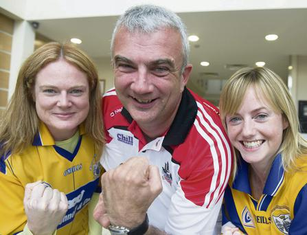 Clare fans Noreen Fitzgerald and Orla O'Callaghan with their boss and Cork fan, MD of Laya Healthcare, Donal Clancy