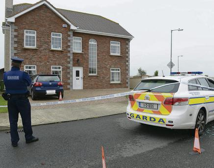 A garda at the scene of the shooting in Termonfeckin, Co Louth.