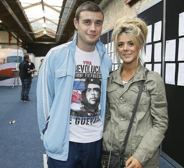 Neil Doyle and his girlfriend Carla Dempsey, who are hoping to move to Canada, at the Working Abroad Expo in the RDS.
