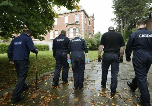 SEARCH: Gardai outside the former home of Tom McFeely, where €200,000 cash was found hidden in a bathroom
