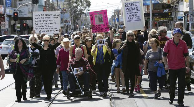 People march in Melbourne to honour the memory of Jill Meagher who was raped and murdered by Adrian Ernest Bayley