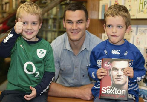 Johnny Sexton with Daragh (5) and Rory Walsh (4) at the book signing in Dubray Books on Grafton Street, Dublin