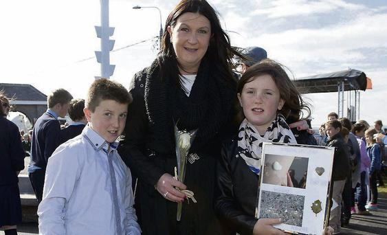 Suzanne Gilsenan, wife of David, with their children Conor and Aoibheann at the launch of a plaque and mast in honour of those who lost their lives at sea in Skerries yesterday