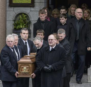 The remains of Peggy Mangan being carried from Mount Argus Church after her funeral