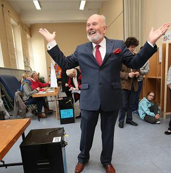 Senator David Norris casts his ballot in a referendum on whether to abolish the country's upper house of parliament