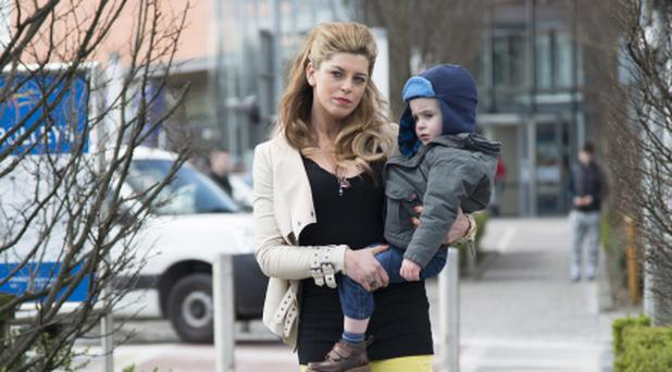 Aoibhinn McGinnity as Trish with baby John