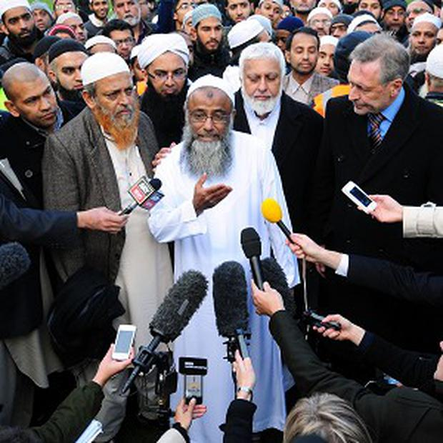 Dr Muhammad Taufiq Al Sattar (centre) at Spinney Hill Park, Leicester, after the funeral prayers for his wife and children