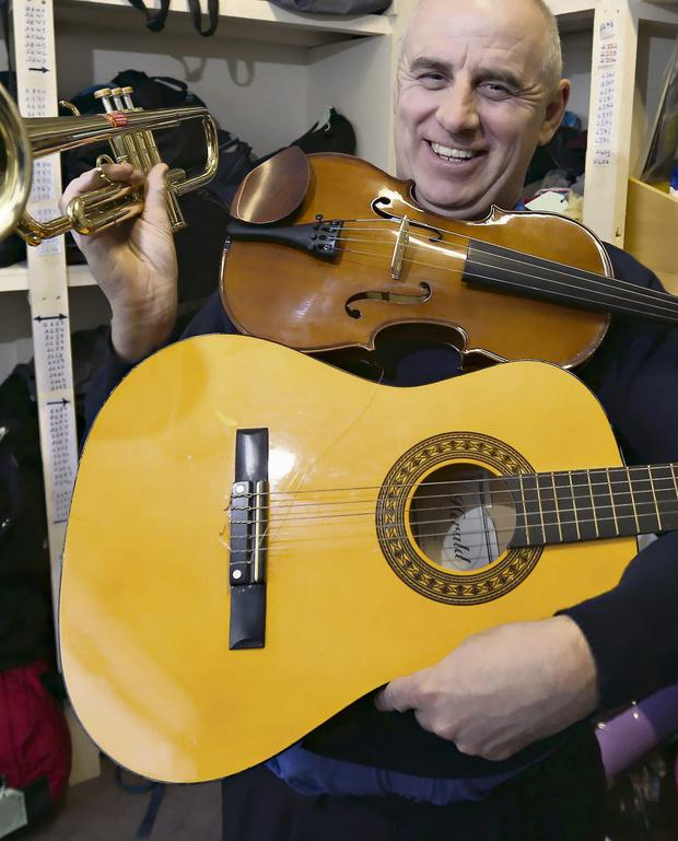 Joe Elliott, from Dublin Bus lost property, with a variety of instruments that were left on Dublin buses