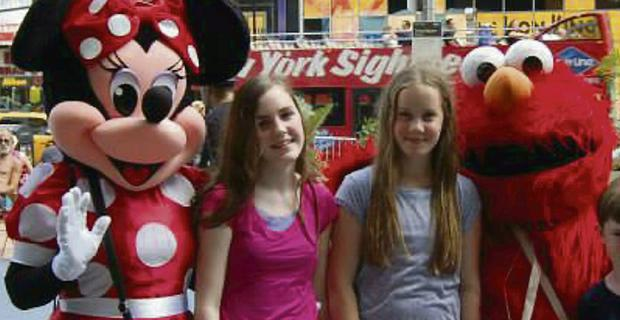 Kalie Gill (15), left, with her sister Lindsey (12) are pictured on holidays in America