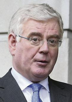 Eamon Gilmore said the decision to slash dole for people aged 22-24 was not a benefit cut.