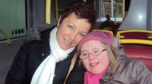 Karen North with her daughter Eve, who has had her medical card axed